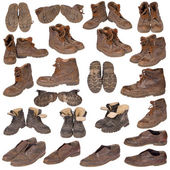 Many old boots on white — Stock Photo