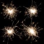 Burning christmas sparkler on black — Stock Photo #8783847