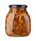 Glass jar with pickled mushrooms — Stock Photo