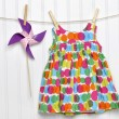 Baby Dress and Pinwheel on a Clothesline — Foto Stock