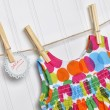 Polka Dot Baby Dress on a Clothesline with Handwritten Sale Sign — Stockfoto