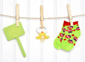 Baby Goods and Blank Sign on a Clothesline — Stock Photo