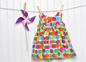 Baby Dress and Pinwheel on a Clothesline — Stock Photo