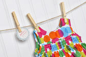 Polka Dot Baby Dress on a Clothesline with Handwritten Sale Sign — Stock Photo