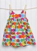 Summertime Baby Girl Dress on a Clothesline. — Stock Photo