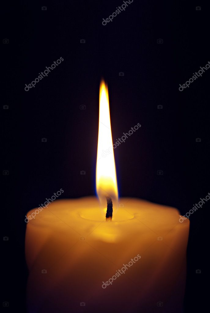 Close-up of a candle flame against a black background. — 图库照片 #10237794