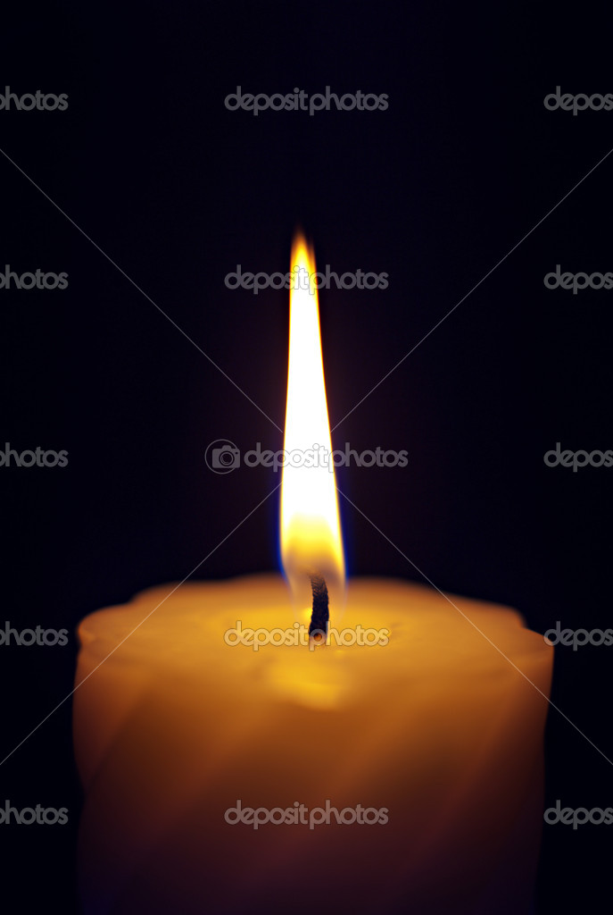 Close-up of a candle flame against a black background.  Photo #10237794