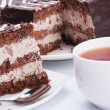 Chocolate cake and cup — Stock Photo