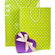 Green paper shopping bags and heart box isolated on white backgr — Stock Photo