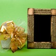 Wood photo frame and heart gift box with ribbon on green backgro - Stock Photo