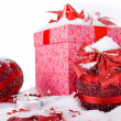Stock Photo: Christmas gift box in snow with red balls and candles