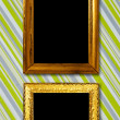 Gold frame on striped vintage wallpaper background — Stock Photo