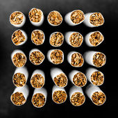 Abstract cigarettes background. Small DOF — Stock Photo