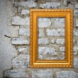 Stock Photo: Gold frame on old wall background