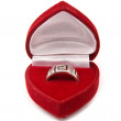 Classic silver ring in red box isolated on a white — Stock Photo #8008335