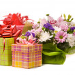 Stock Photo: Magnificent bouquet and present boxes on white