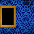 Royalty-Free Stock Photo: Gold frame on a vintage blue wall background