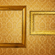 Stock Photo: Vintage frame over golden wallpaper