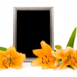 Yellow lilies and silver frame on a white background — Stock Photo
