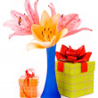 Stock Photo: Beautiful lilies and gift box on a white background