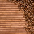 Coffee beans on wooden background — Stock Photo #8070348