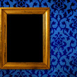 Gold frame on a vintage blue wall background — Stock Photo