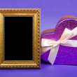 Stock Photo: Gold photo frame and heart gift box with ribbon on blue backgrou