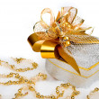 Stock fotografie: Christmas silver heart gift box with golden ribbon in snow on a