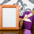 Wooden photo frame and present box on table - 