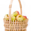 Stock Photo: Ripe apples in basket on white background
