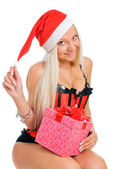 Sexy young blond woman wearing a corset and a Santa's hat with C — Stock Photo