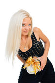 Blonde woman holding gift box over white background — Stock Photo