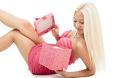 Beautiful sexy blonde woman in pink dress with red present box i — Stock Photo