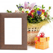 Gift box and wooden picture frame with flowers on white backgrou - Stock Photo