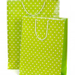 Green paper shopping bag isolated on white background - Stock Photo