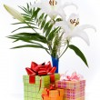 Stock Photo: Beautiful bouquet in basket and present boxes on white bac