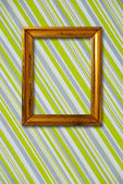 Gold frame on striped vintage wallpaper background — Stockfoto