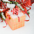 Christmas tree in the snow with red balls and gift box — Stock Photo #9827230