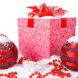 Stock Photo: Christmas gift box in the snow with red balls and candles