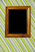 Gold frame on striped vintage wallpaper background — Stock Photo