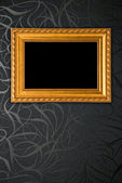 Gold frame on black vintage wallpaper background — Stock Photo