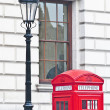 Red telephone at London, England — Stockfoto