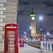 Red telephone at London, England - Stock Photo