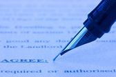 Fountain pen and printed agreement — Stock Photo