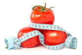 Tomatoes wrapped with measuring tape — Stock Photo