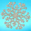 Snowflake isolated on blue background - Zdjęcie stockowe