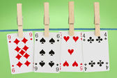 Playing cards hung on clothesline — Zdjęcie stockowe