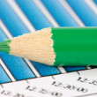 Royalty-Free Stock Photo: Green pencil on financial graphs