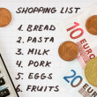 Shopping list with calculator and money - Stock Photo