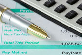 Pen,calculator and payslip — Stock Photo